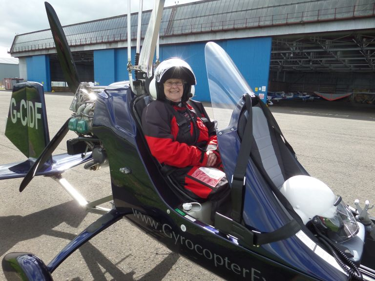 Mary Campbell, mesothelioma victim, pictured in gyro copter