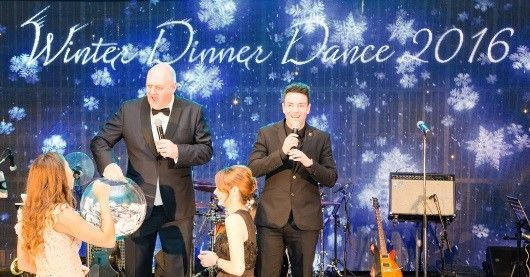 Dara Ó Briain draws the lucky winner of a brand new car at Digby Brown's Winter Dinner Dance for Spinal Injuries Scotland