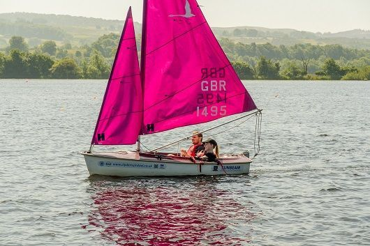Guests with spinal injuries get the opportunity to try sailing