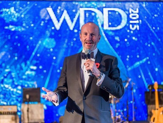 Comedian Fred MacAulay on stage at the Winter Dinner Dance 2015