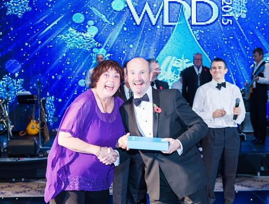 Comedian Fred MacAulay on stage at the Winter Dinner Dance 2015 giving out prizes