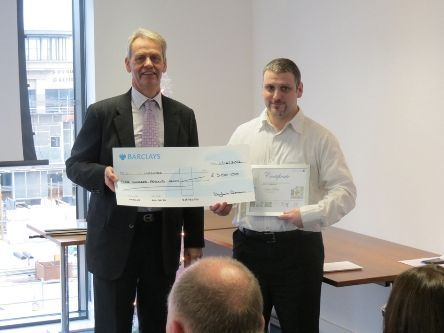 Headway Christimas Card Winner 2012 with Head of Serious Injuries Partner giving him a cheque for winning the competition