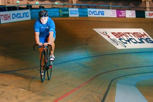 John Paul cycling around the velodrome