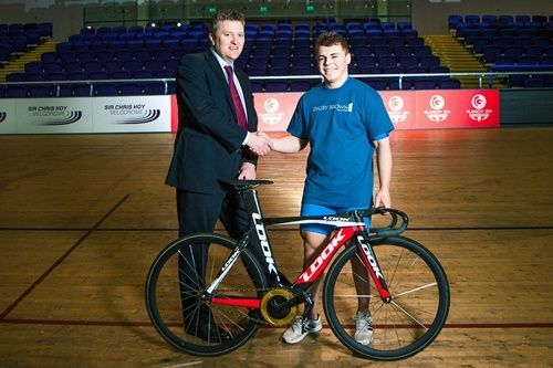 John Paul star cyclist shaking hands with Fraser Oliver, CEO of Digby Brown