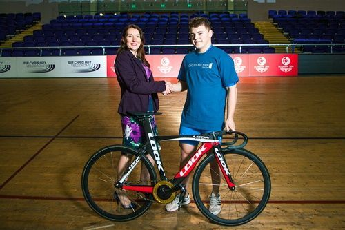 John Paul star cyclist shaking hands with Laura McManus, Head of Digby Brown specialist cycling law team