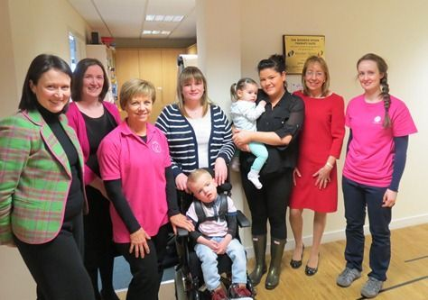 Photo showing Stephanie Fraser, Ruth Kelliher, Catharina van der Walt(Head of Therapy, Bobath Scotland), Oliver Syme and his mum, Danielle Wilson, Macie McCann being hled by mum Jodie Welsh, Sue Grant, Sandra Mackay (Occupational Therapist, Bobath Scotland)