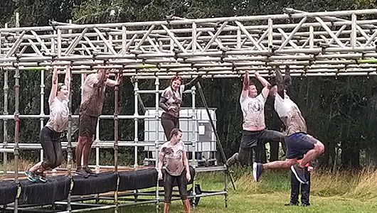 Inverness Office on monkey bars at Beast Race 2019